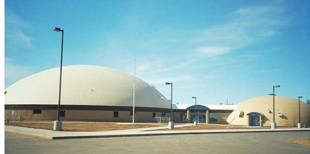 Heber-Overgaard — Their new school campus, opened in January 1999, features two Monolithic Domes, connected by a corridor.