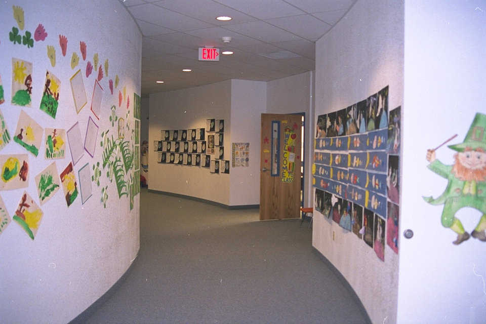 Connecting Corridor — Besides providing access to both domes, the much traveled corridor works as a display area for student art.