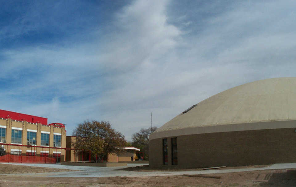 Old and new — In 1910 Texhoma built its first brick building, and in 2000 it built its first Monolithic Dome school facility.