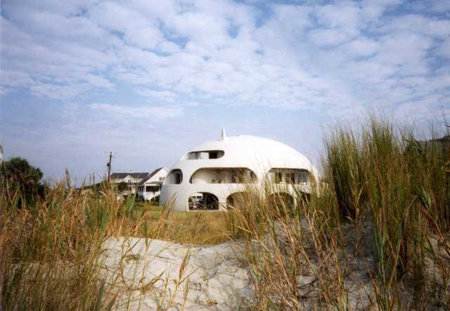 "Eye of the Storm — View of ""Eye of the Storm"" dome home from the beach on Sullivans Island, SC. The ""Eye of the Storm"" is much more than a pretty house, it also demonstrates the practical aspects of a Monolithic Dome on beach front property."