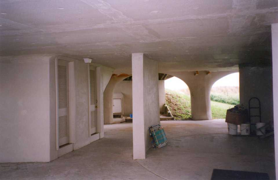 Garage — The bottom floor is completely open and the upper floors are actually suspended from the dome. During severe weather, storm surge can fill the entire garage without damage to the living spaces above. Repairs costs are limited to only the minor walls in the garage.