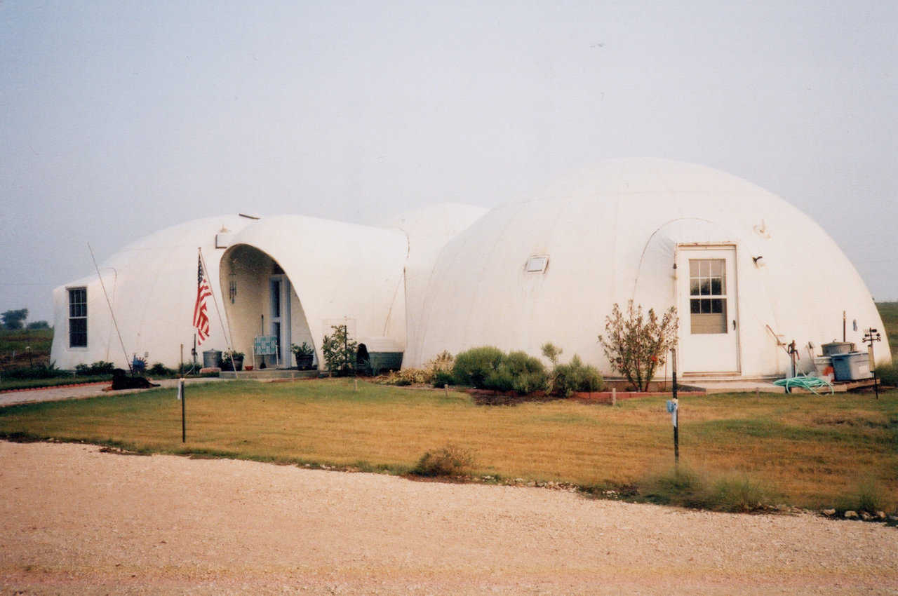 A Texan's Dome Home — It consists of 3, interconnected Monolithic Domes. Central dome is 28' in diameter and 14' tall. Two slightly larger domes, each 32′ × 14′, flank the middle dome.