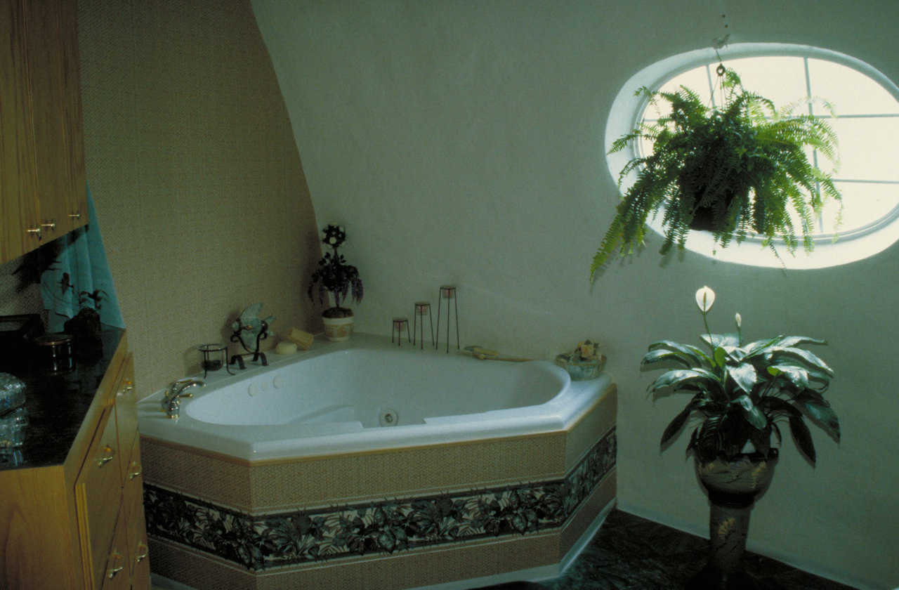 Whirlpool tub  — A surrounding shelf makes the tub fit against the dome's rounded walls.