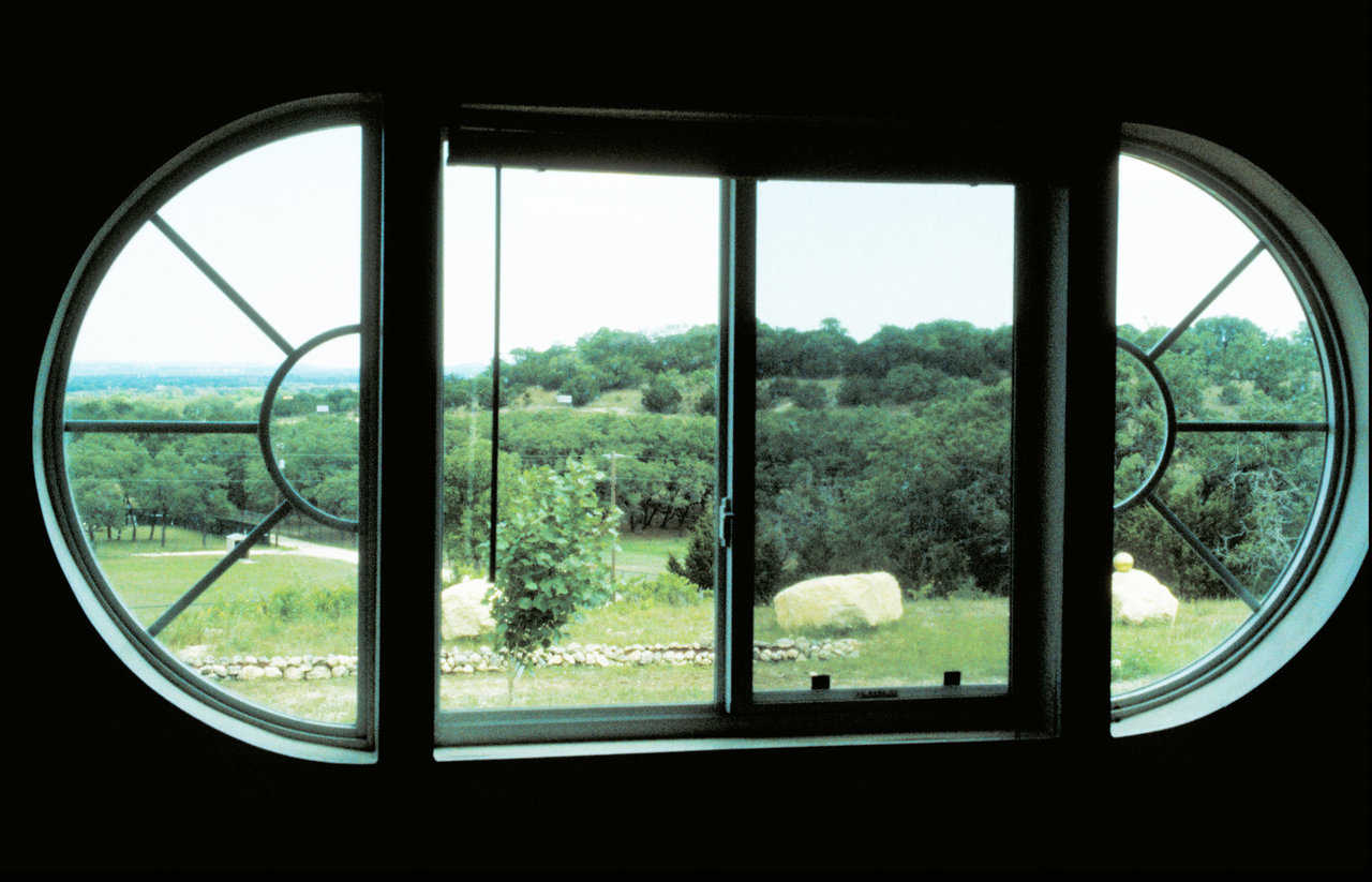 A bit of Texas — The curved window gives the residents of this Monolithic Dome home a lovely view.