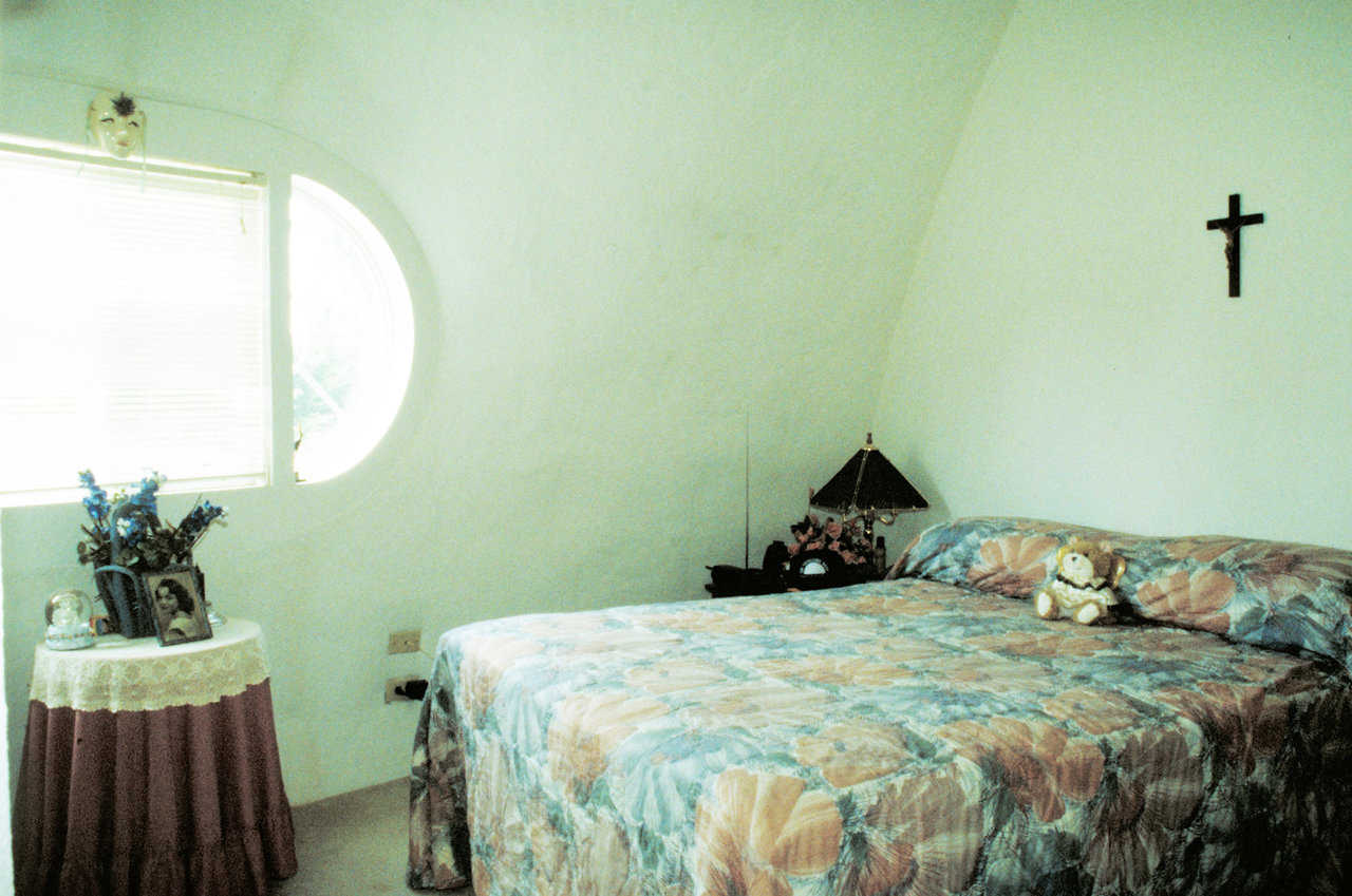 Bedroom — Its rounded windows, curves and arches provide a soothing serenity.