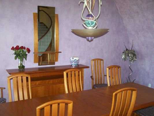 Dining — Its long, rectangular table can accommodate eight.