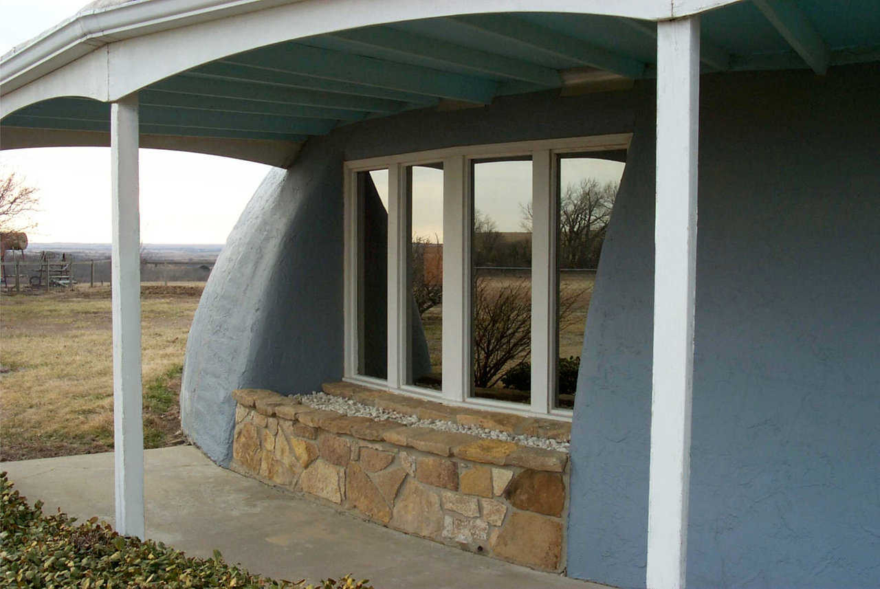 Stewarts' Monolithic Dome home — Many years after it was built, the Stewarts enjoy the comfort and energy benefits of their 50-foot dome home near Eureka, Kansas.