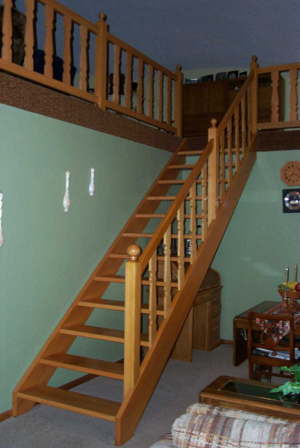 Going up! — The solid wooden staircase matches the wood trim in other areas of the home and leads to the upper loft.