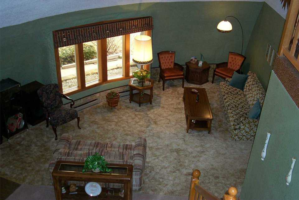 Upstairs view of living room — The living room has comfortable areas for entertaining and just relaxing.