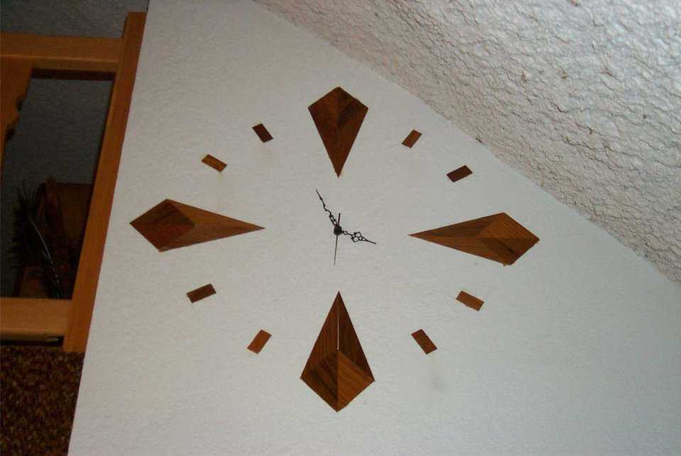 Wall clock — A handmade clock, designed and built by Boyd Stewart is built into the wall.