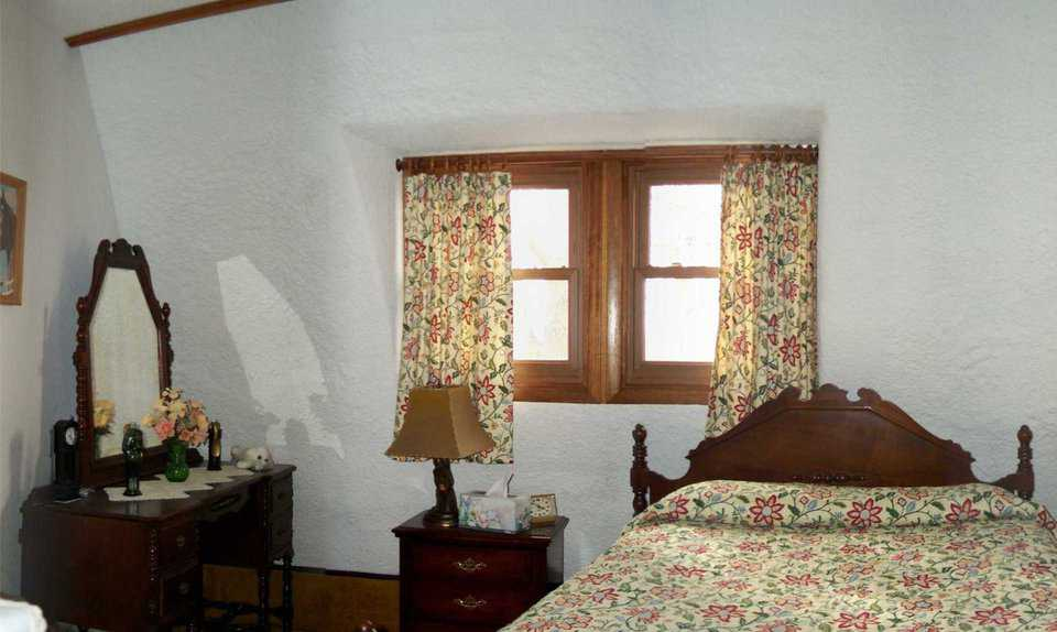 Guest bedroom — The Stewarts furnished their beautiful, large, guest bedroom with family antiques.