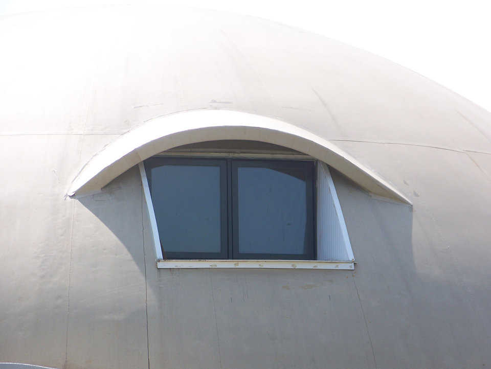 Window with an eyebrow — The eyebrow is a rebar frame epoxied into the concrete shell, sheathed with a plywood and foam sandwich, and topped with more Airform fabric.