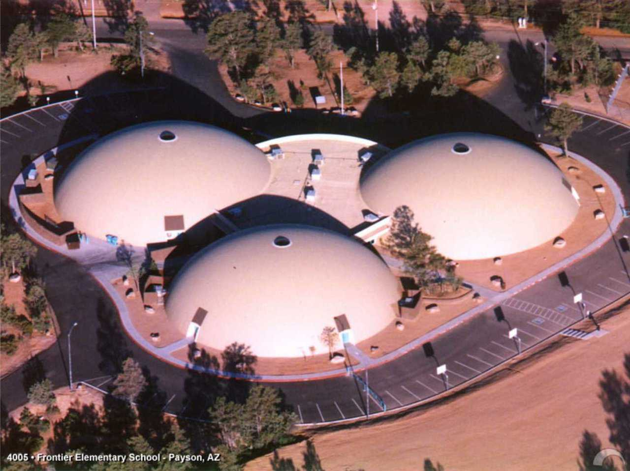 Three round structures — Visitors are surprised by the roominess and openness of the interior of these Monolithic Domes.