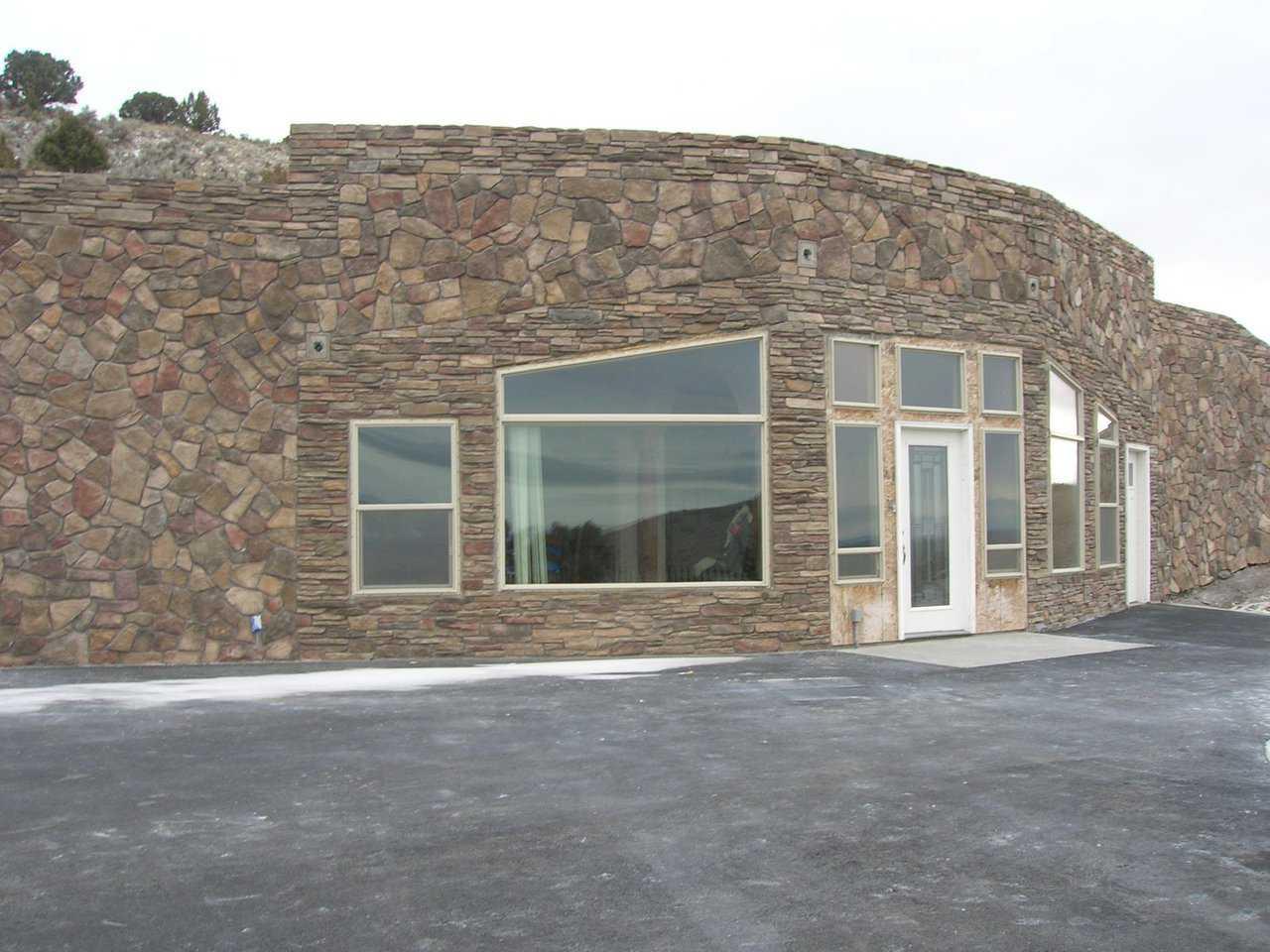 Earth bermed nature friendly energy efficient monolithic for Earth bermed homes