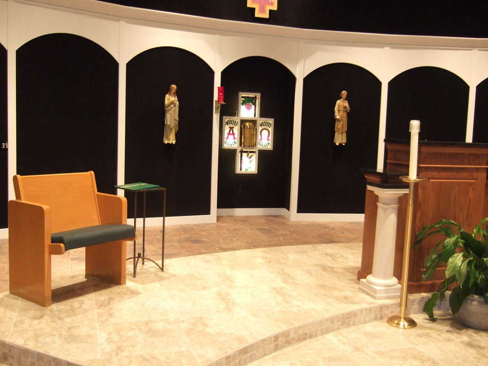Beloved, familiar items — Two religious statues and four stained glass panels, that were part of St. Joseph's original church, now adorn the wall in back of the altar at the new church.