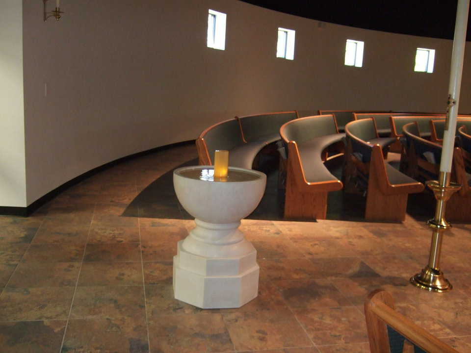 Baptismal font — Father Monaghan found a local artisan to design and craft a font whose lines and shape complement that of the dome.
