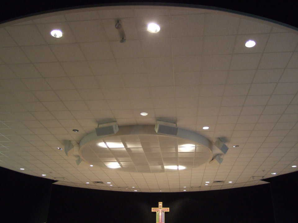 Ceiling — This sparkling white, acoustical, drop-in ceiling is an assembly of rectangular tiles within a circle. Heating and air conditioning equipment sits in the space between the ceiling and the top of the dome.
