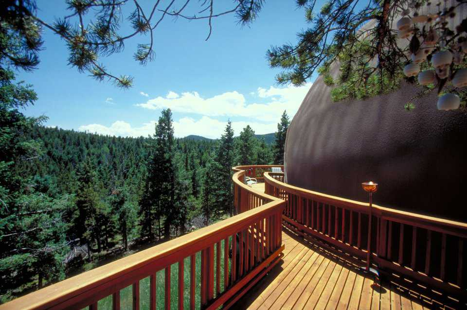 Walk in the treetops — The finely crafted, redwood deck has a walkway that seems to reach into the treetops.