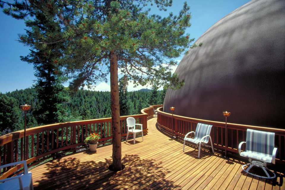Redwood deck — It has a ponderosa pine growing through it.