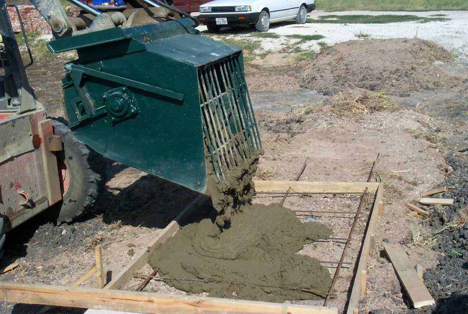 The Monolithic Mixer can discharge concrete by dumping it out, like you would a common skid steer bucket.  This can be used to pour side walks, floors, and much more.