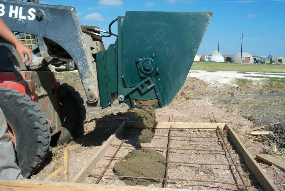 The Monolithic Mixer can also discharge from a chute on the side.  This side dump is especially handy for filling post holes, pilings, etc.