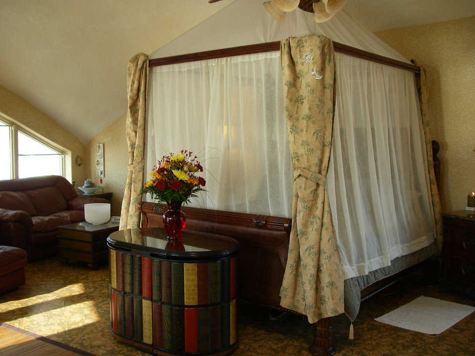 ultimate privacy this master bedroom features a canopied fully curtained queen size bed