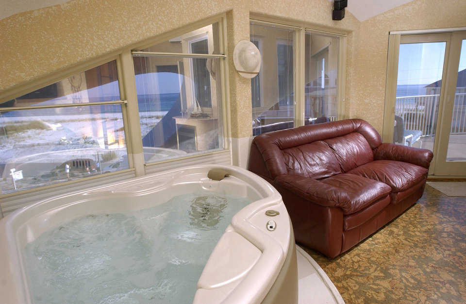 Master bath — You can relax in the generously proportioned whirlpool tub or on a soft leather sofa.