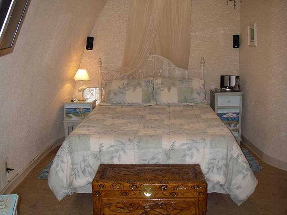 Second guest bedroom — It has a comfortable, queen-size bed and an unusual chest.