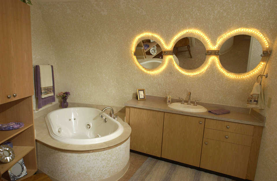 Guest bath — It includes lighted mirrors and plenty of storage space.