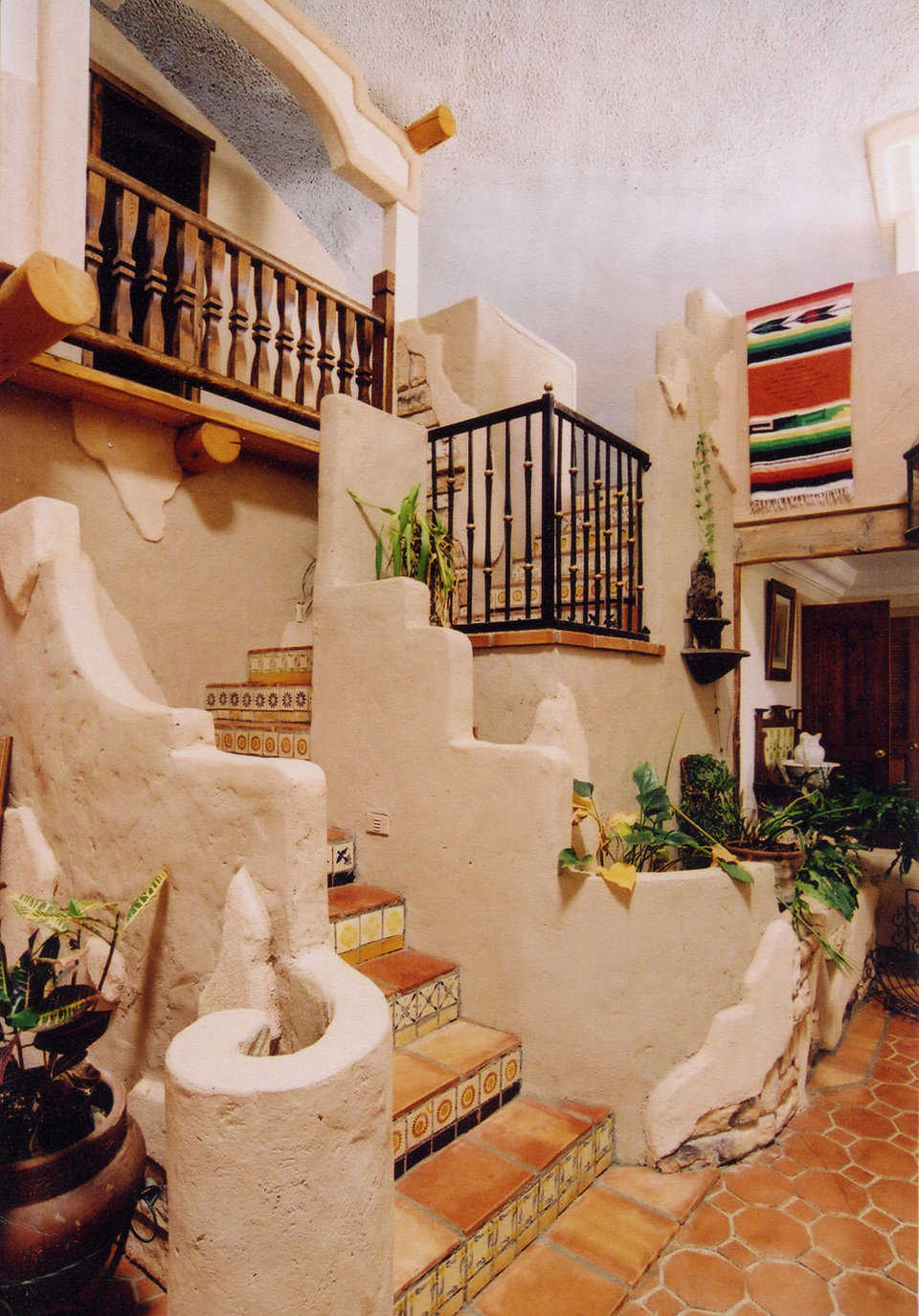 Stairway — Its Mosaic tiles lead to the upper level living areas.
