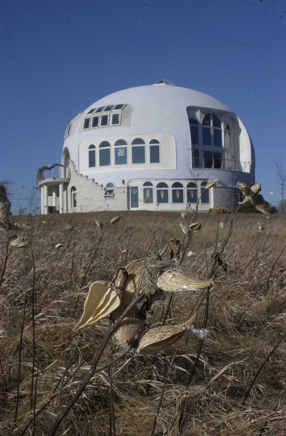 The Disappearing Dome — This dream-come-true home in Manitowoc, Wisconsin is a Monolithic Dome with a diameter of 55 feet and three stories. It overlooks Lake Michigan and on foggy days because almost invisible.