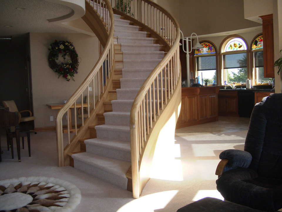 Custom Stairway —  A graceful, winding stairway leads to the second floor.