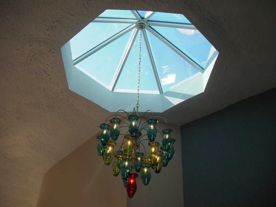 Unique Touches — A beautiful, glass chandelier hangs from a skylight.