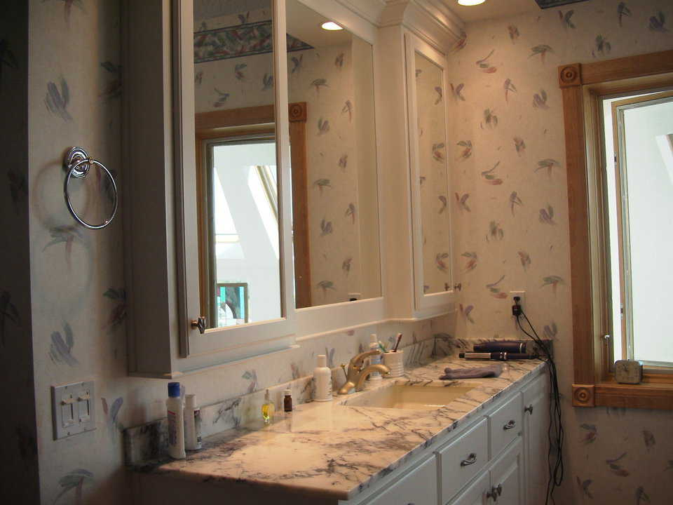 Twin Bathrooms — This dome-home includes his and her bathrooms, each with marble countertops.