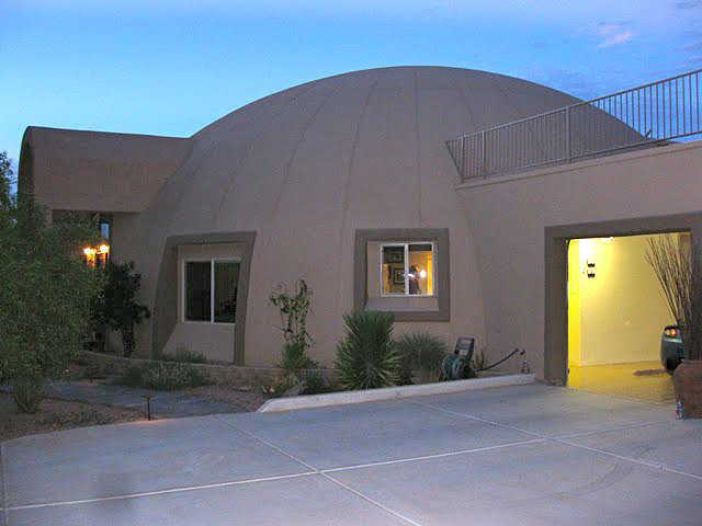 Garage – A rectangular, stucco 4-car garage is attached to the dome-home.