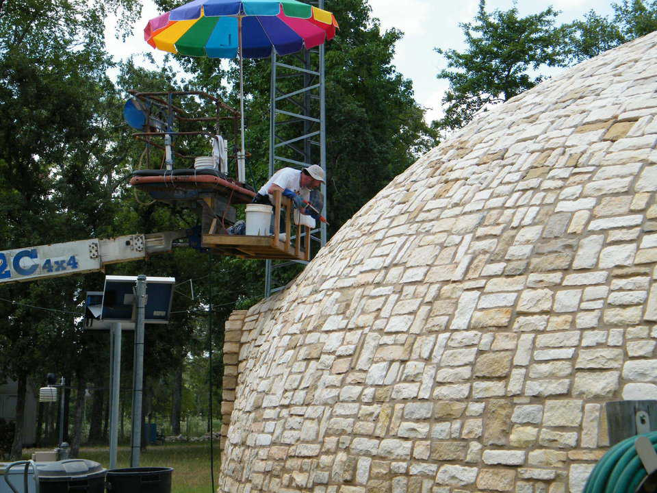 Getting up there! – To stone the very top of the dome, the Tassells used a manlift, loaned to them by Amy and Bob Brooks.
