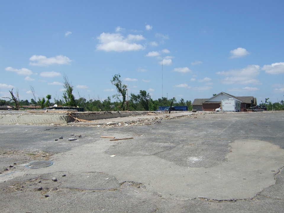 Note the concrete foundations. Unexplainably, entire blocks of homes were flattened, yet one was left virtually untouched.
