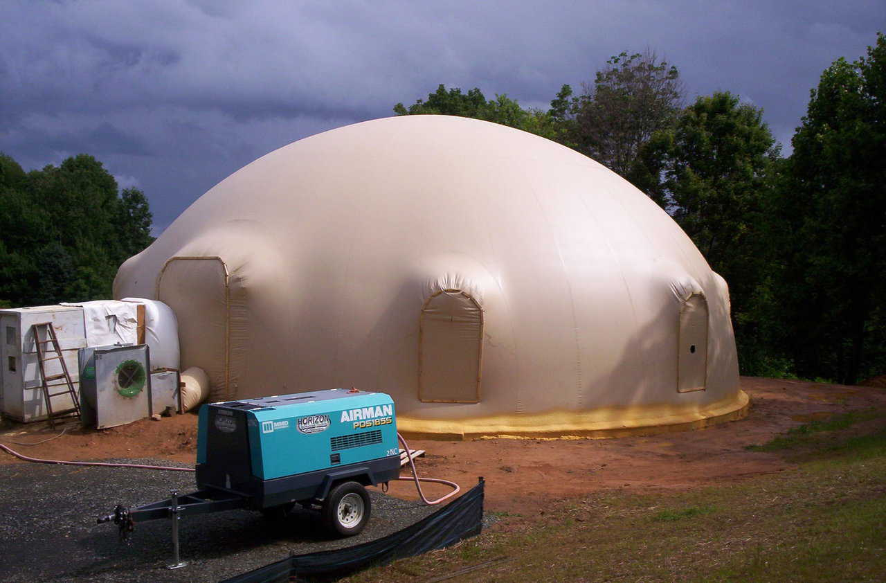 The Ecker dome-home — after the Airform was inflated, its perimeter was sprayed with leftover, two-part, closed cell foam. It's clearly visible as a bright yellow band along the foundation.