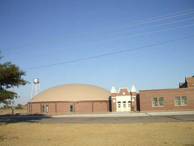 In designing a new Monolithic Dome to adjoin an existing, rectangular school building, Architect Gray used bricks whose color matched that of the bricks in the old building.