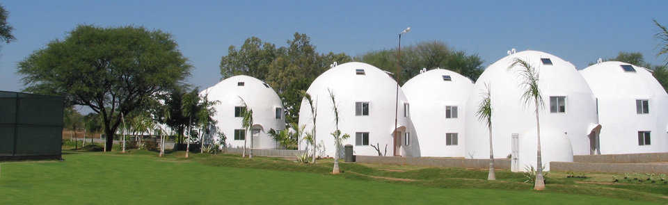 In New Oroville, India, Catalytic Software built a company-campus that includes Monolithic EcoShell multistory homes.