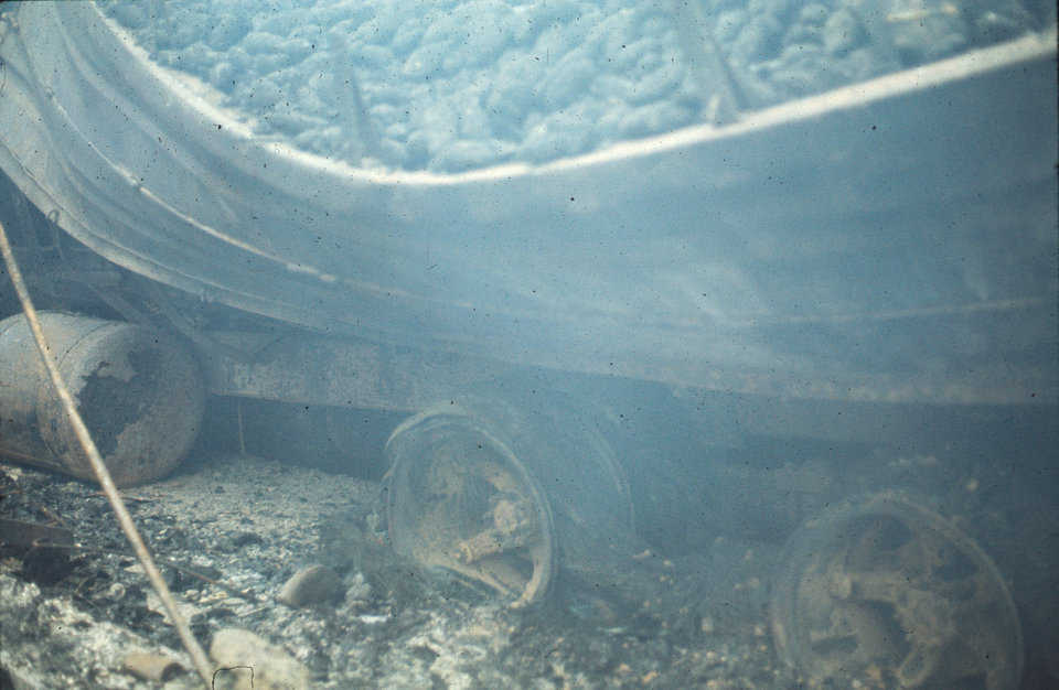Fire goes from bad to worse.   The truck tires fed the fire with heat and smoke. The insulation increased temperature which increased the speed at which the tires burned. The increased heat drooped the steel and melted the aluminum into puddles.