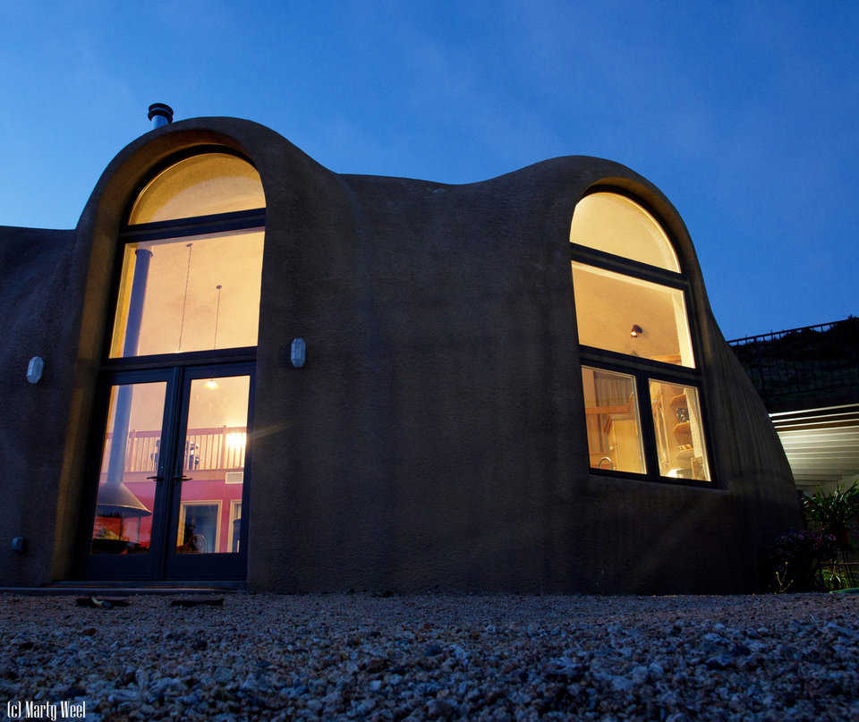 This Monolithic Dome home, built on a stemwall, has two levels, a diameter of 48 feet, a height of 25 feet and a total living area of 2295 square feet.