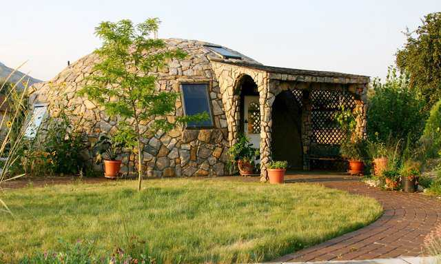 800-square-foot, spectacular, small home in Brigham, Utah. No A/C needed. Open windows at night to cool it. It stays cool all day. Owner Lori Hunsaker did the rock cover on the exterior herself.