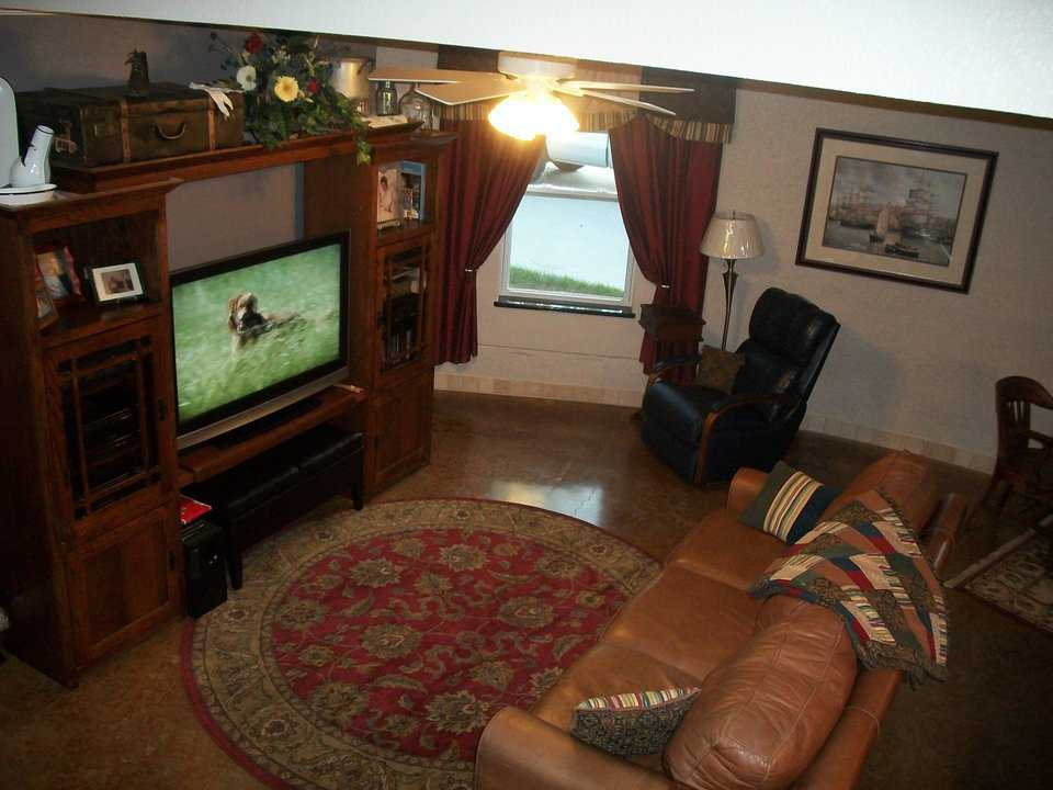 The living area includes a large TV.