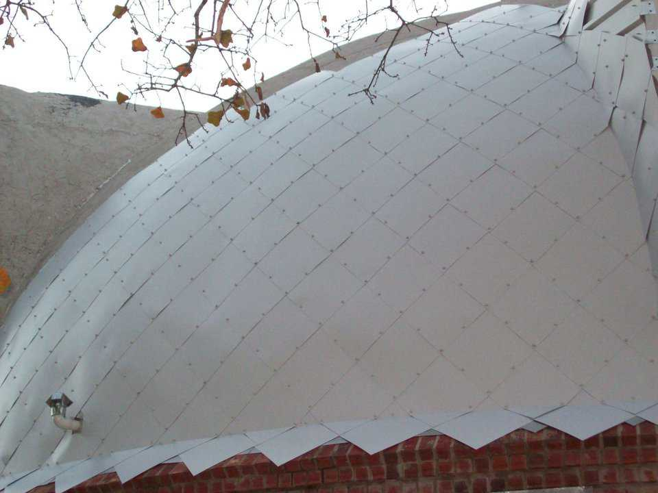 Sparkling white metal tiles cover Claddagh Dome's roof.