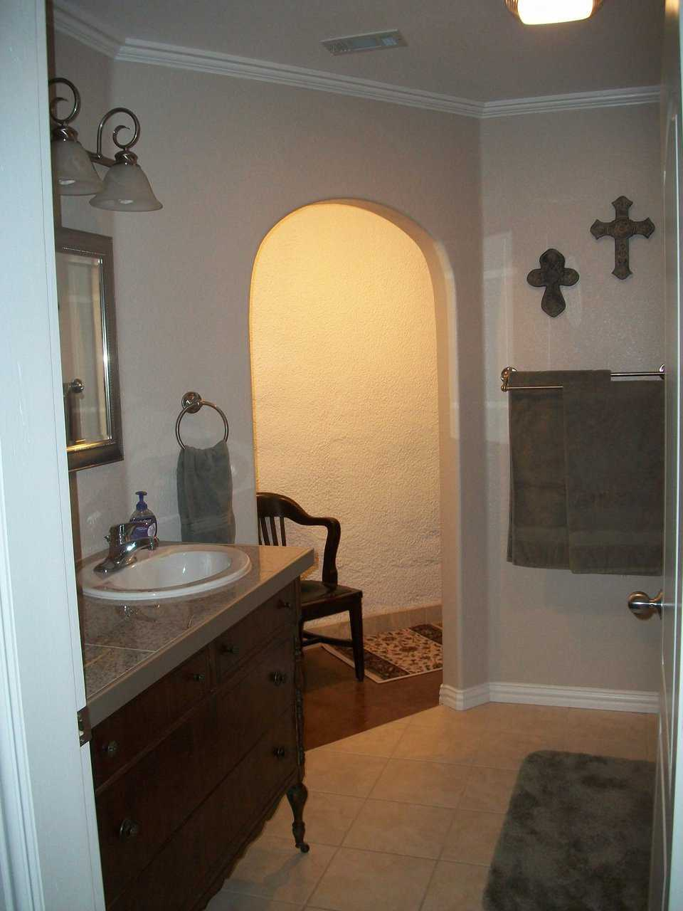 The master bath is roomy and elegant.