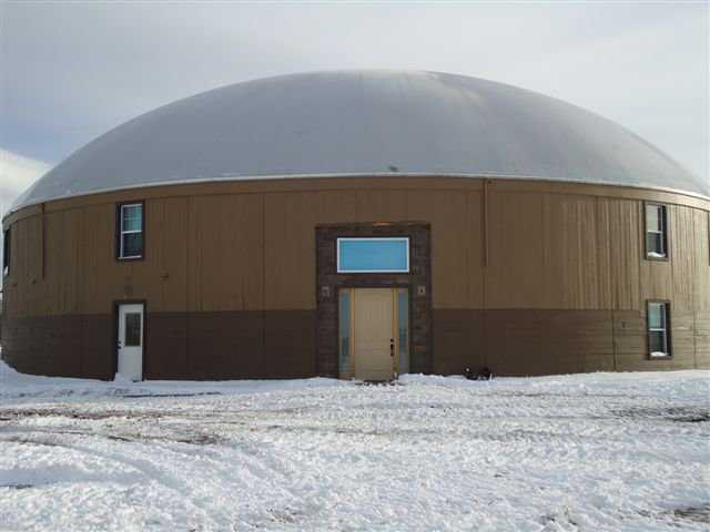 This spacious Monolithic Dome has a 90-foot diameter and two stories.