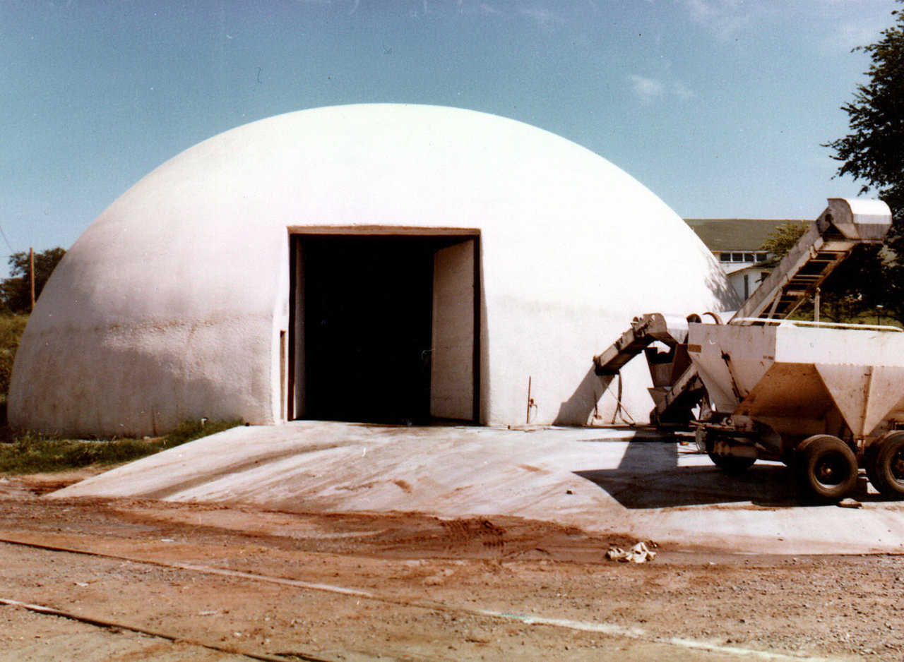 In 1978, this Monolithic Dome, fertilizer blend plant was constructed in Chandler, Oklahoma. It has a diameter of 75 feet and a height of 25 feet and is still in use today.   See next image for same building with stainless steel cladding, which was installed 30 years later.