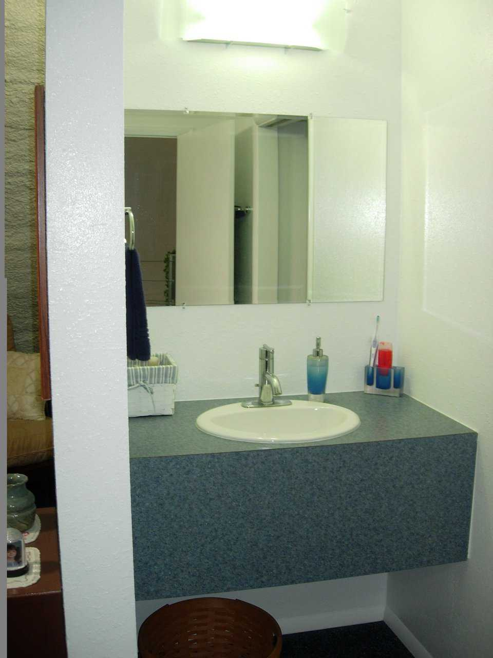 Bathroom is attractive and easily maintained.