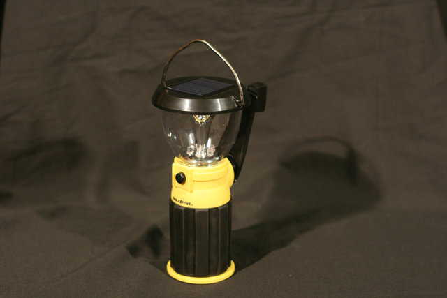 This LED emergency lantern can charge itself in the sun, or it can be charged by turning its handle for a couple of minutes.